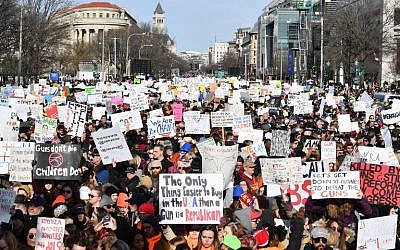 People arrive for the March For Our Lives rally against gun violence in Washington, DC on March 24, 2018. (AFP PHOTO / Nicholas Kamm)