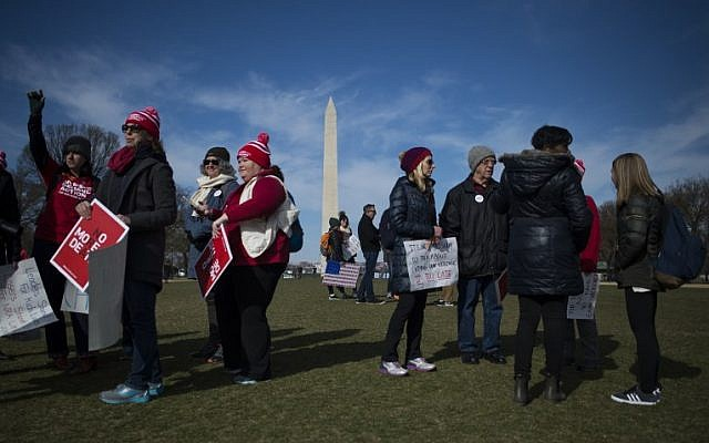 Photo Essay: Thousands rally to bring families together