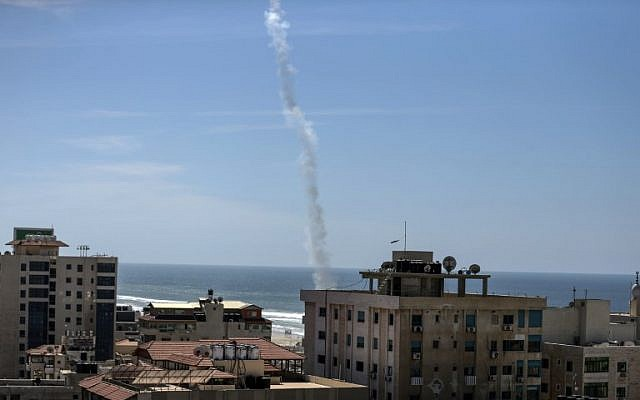 The smoke of a rocket fired by Palestinian Hamas is seen over Gaza City on March 25, 2018 as they take part in a military drill. (AFP/MAHMUD HAMS)