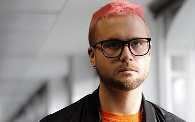 Canadian data analytics expert and whistle-blower, Christopher Wylie poses for photographs outside a press conference in London on March 26, 2018.  (AFP PHOTO / Tolga AKMEN)
