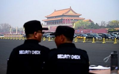 Two security guards watch near the Tiananmen Square in Beijing on March 27, 2018. Speculation intensified on March 27, 2018 that North Korean leader Kim Jong-Un was in Beijing for a surprise visit, after Japanese media reported the arrival of a special North Korean train met by an honour guard under tight security. ( AFP PHOTO / WANG ZHAO)