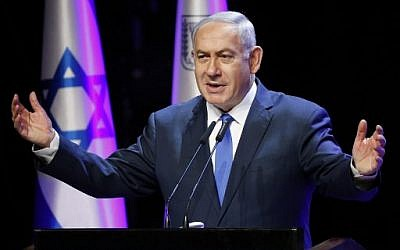 Prime Minister Benjamin Netanyahu addresses the annual health conference in Tel Aviv on March 27, 2018. ( AFP PHOTO / JACK GUEZ)