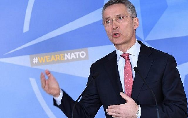 NATO Secretary General Jens Stoltenberg addresses the press at NATO headquarters in Brussels on March 27, 2018.  (AFP PHOTO / Emmanuel DUNAND)