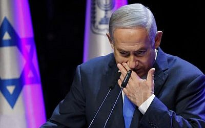 Prime Minister Benjamin Netanyahu coughing while addressing an annual health conference in Tel Aviv on March 27, 2018.  (AFP / JACK GUEZ)