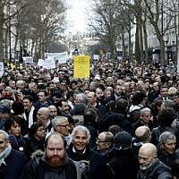 Participants walk behind banners holding placards during a silent march in Paris in memory of Mireille Knoll, an 85-year-old Jewish woman murdered in her home in what police believe was an anti-Semitic attack, held on on March 28, 2018. (Francois Guillot/AFP)