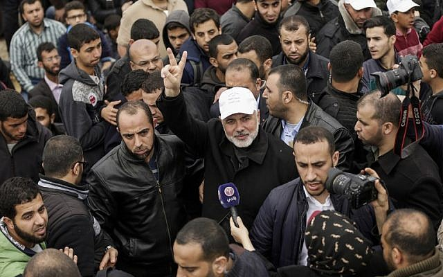 Hamas leader Ismail Haniya flashes the victory gesture during a demonstration near the border with Israel east of Gaza City to commemorate Land Day on March 30, 2018 (AFP PHOTO / MAHMUD HAMS)