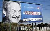 A billboard with a poster of Hungarian-American billionaire and philanthropist George Soros with the words 'National consultation about the Soros plan - Don't let it pass without any words' is seen in Budapest on October 16, 2017. (Attila Kisbenedek/AFP)