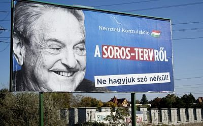 """A billboard with a poster of Hungarian-American billionaire and philanthropist George Soros with the words """"National consultation about the Soros plan - Don't let it pass without any words"""" is seen in Budapest on October 16, 2017. (Attila Kisbenedek/AFP)"""