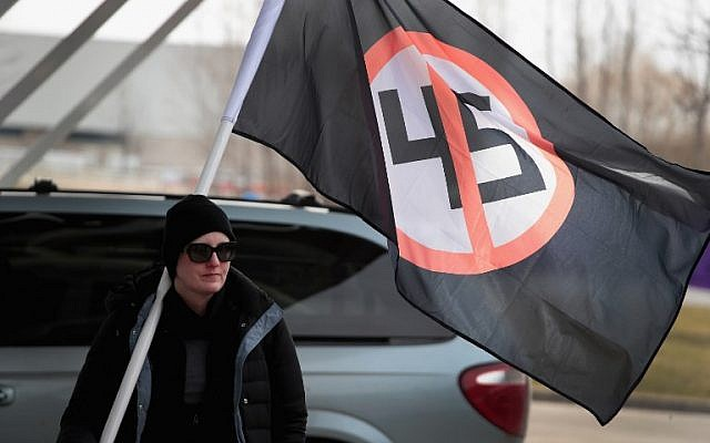 Demonstrators at Michigan State University protest a speech by white nationalist Richard Spencer, who popularized the term 'alt-right', on March 5, 2018 in East Lansing, Michigan. Spencer was granted permission to speak after suing the university which is currently on spring break.   (Scott Olson/Getty Images/AFP)