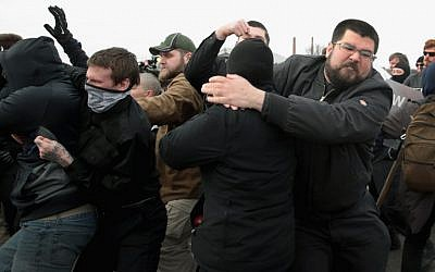 White nationalist Matthew Heimbach fights with demonstrators at Michigan State University as he and other alt-right advocates try to attend a speech by white nationalist Richard Spencer on March 5, 2018 in East Lansing, Michigan. (Scott Olson/Getty Images/AFP)