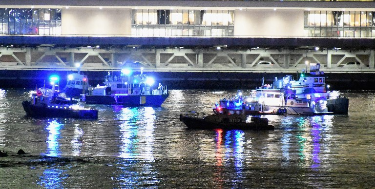 Helicopter down in the East River, officials say