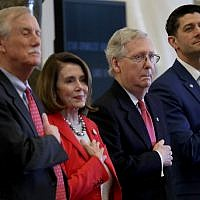 (L-R) Sen. Angus King (I-ME), Speaker of the House Paul Ryan (R-WI), House Minority Leader Nancy Pelosi (R-CA), and Senate Majority Leader Mitch McConnell (R-KY) place their hands over their hearts during the playing of the national anthem during a Congressional Gold Medal award ceremony for the Office of Strategic Services at the US Capitol March 21, 2018 in Washington, DC. (Win McNamee/Getty Images/AFP)