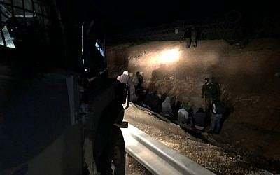 Security forces arrest dozens of Palestinians trying to enter Israel without work permits, south of Jerusalem, on March 4, 2018. (Israel Defense Forces)