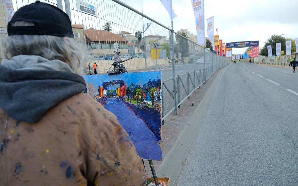 A man paints the finish line of the international Jerusalem Marathon on March 9, 2018. (Flash90 via Jerusalem municipality)