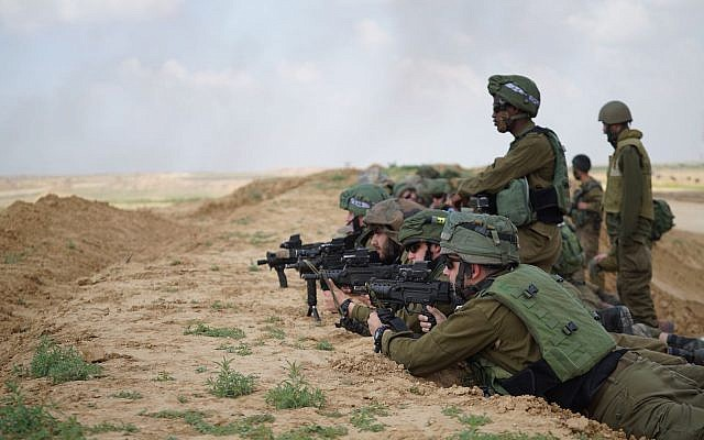 Illustrative: Israeli soldiers prepare for massive protests by Palestinians in Gaza on March 30, 2018. (Israel Defense Forces)