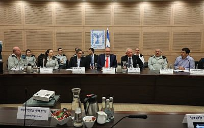 Defense Minister Avigdor Liberman, center, along with senior officials from the IDF and Defense Ministry, takes part in a Knesset committee hearing about the defense budget on March 4, 2018. (Knesset
