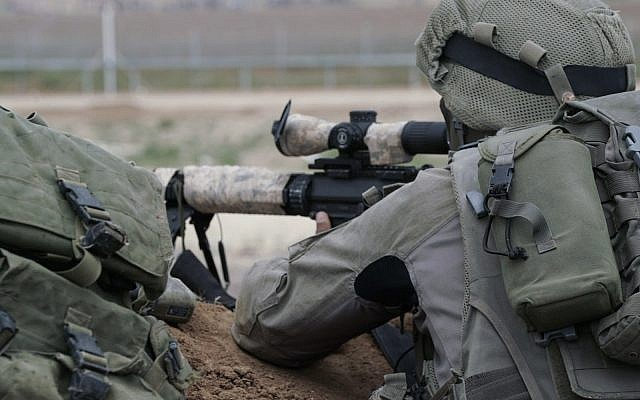 Illustrative: Israeli snipers prepare for massive protests by Palestinians in Gaza and the potential for demonstrators to try to breach the security fence on March 30, 2018. (Israel Defense Forces)