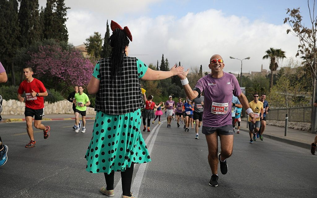 Runners take part in the international Jerusalem Marathon on March 9, 2018. (Flash90 via Jerusalem municipality)