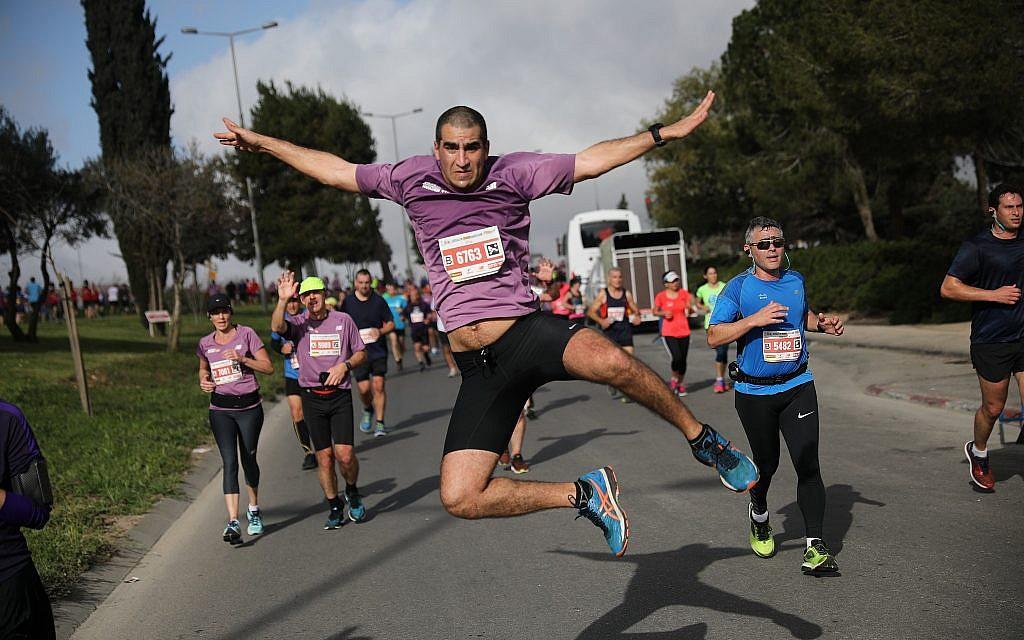 Runners take part in the international Jerusalem Marathon on March 9, 2018. (Flash90 via Jerusalem municipality)