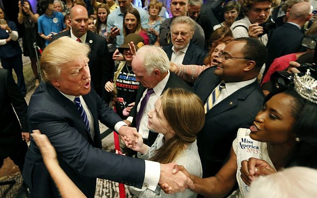In this September 23, 2015 file photo, Republican presidential candidate Donald Trump, left, shakes the hand of Miss South South Carolina Daja Dial, after speaking at an event sponsored by the Greater Charleston Business Alliance and the South Carolina African American Chamber of Commerce at the Charleston Area Convention Center in North Charleston, South Carolina. (AP Photo/Mic Smith, File)