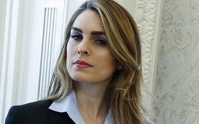 In this February 9, 2018 photo, White House Communications Director Hope Hicks is shown during a meeting in the Oval Office between US President Donald Trump and Shane Bouvet, in Washington. (AP Photo/Evan Vucci)