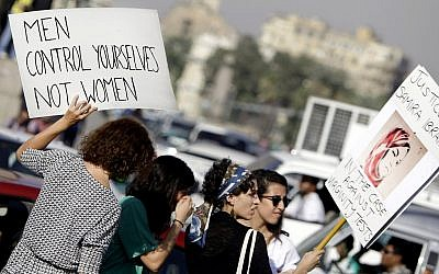 Illustrative: In this June 14, 2014 photo, Egyptian women hold banners during a protest against sexual harassment in Cairo, Egypt. (AP Photo/Amr Nabil)