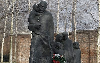 Flowers are placed at the memorial to Janusz Korczak who died in the gas chamber of the Treblinka Nazi German death camp in 1942 together with the children of the Jewish orphanage that he ran in the Warsaw Ghetto, at the Jewish cemetery in Warsaw, Poland, Thursday, March 1, 2018. (AP Photo/Czarek Sokolowski)