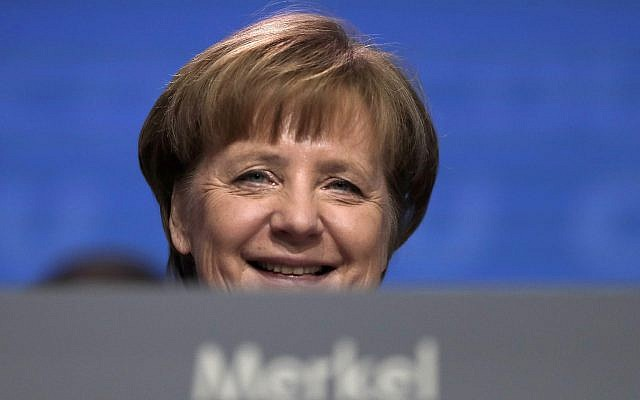 German Chancellor and party chairwoman Angela Merkel smiles at the party convention of the Christian Democratic Union in Berlin on February 26, 2018. (AP Photo/Markus Schreiber, file)
