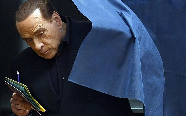 Italian former prime minister and leader of 'Forza Italia' party Silvio Berlusconi votes in a polling station in Milan, March 4, 2018. (Daniel Dal Zennaro/ANSA via AP)
