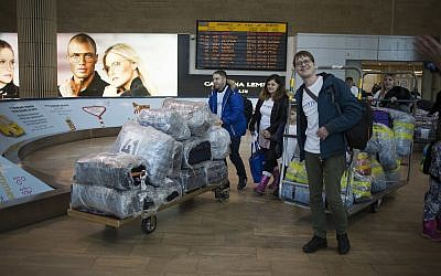In this January 30, 2018, photo, new Jewish immigrants from the Ukraine arrive on a flight funded by the International Fellowship of Christians and Jews, at the Ben Gurion airport near Tel Aviv, Israel. (AP Photo/Ariel Schalit)