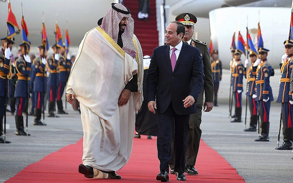 Egyptian President Abdel-Fattah el-Sissi, right, greets Saudi Crown Prince Mohammed bin Salman on his arrival to Cairo, Egypt, for a visit meant to deepen the alliance between two of the region's powerhouses, on March 4, 2018. (Mohammed Samaha/MENA via AP)