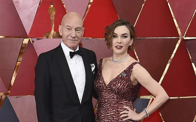 Patrick Stewart, left, and Sunny Ozell arrive at the Oscars on Sunday, March 4, 2018, at the Dolby Theatre in Los Angeles. (Richard Shotwell/Invision/AP)