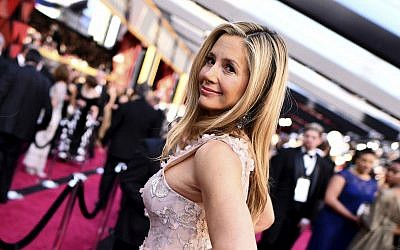 Mira Sorvino arrives at the Oscars on Sunday, March 4, 2018, at the Dolby Theatre in Los Angeles. (Charles Sykes/Invision/AP)