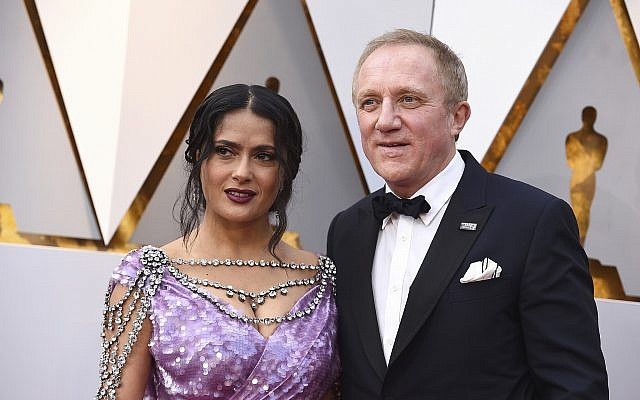 Salma Hayek, left, and Francois-Henri Pinault arrive at the Oscars on Sunday, March 4, 2018, at the Dolby Theatre in Los Angeles. (Jordan Strauss/Invision/AP)