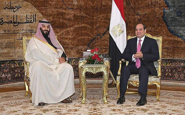 In this photo from March 4, 2018, provided by Egypt's state news agency, MENA, Egyptian President Abdel-Fattah el-Sissi, right, meets with Saudi Crown Prince Mohammed bin Salman in Cairo, Egypt. (Mohammed Samaha/MENA via AP)
