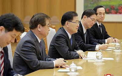 In this Monday, March 5, 2018 photo, provided by the North Korean government, South Korean National Security Director Chung Eui-yong, center, talks with North Korean leader Kim Jong Un, unseen, in Pyongyang, North Korea (Korean Central News Agency/Korea News Service via AP)