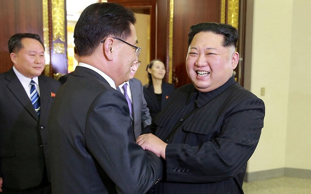 In this Monday, March 5, 2018 photo, provided by the North Korean government, North Korean leader Kim Jong Un, front right, meets South Korean National Security Director Chung Eui-yong, front left, in Pyongyang, North Korea (Korean Central News Agency/Korea News Service via AP)