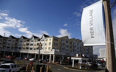 In this Monday, March 5, 2018 photo, the Pier Village development is seen in Long Branch, NJ. The federal government has been advising a beach town on the Jersey Shore on plans to build a pier and start a ferry service that would speed New Yorkers to the doorstep of a resort co-owned by Jared Kushner. (AP Photo/Seth Wenig)