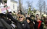 Anti-government protesters shout slogans during ceremonies marking the 50th anniversary of student protests that were exploited by the communists to purge Jews from Poland, at the Warsaw University in Warsaw, Poland, Thursday, March 8, 2018. (AP /Alik Keplicz)