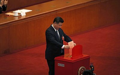 Chinese President Xi Jinping casts his vote for an amendment to China's constitution that will abolish term limits on the presidency and enable him to rule indefinitely, during a plenary session of the National People's Congress at the Great Hall of the People in Beijing, March 11, 2018. (AP Photo/Andy Wong)