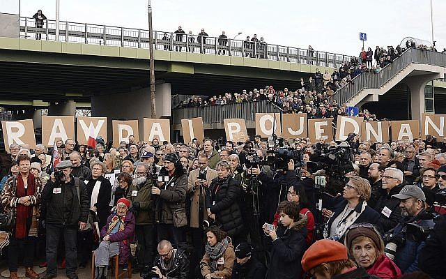 Hundreds of Poles gathered to express their solidarity with Jews who perished in the Holocaust, were expelled from Poland 50 years ago or feel the effects of anti-Semitism today, in Warsaw, Poland, March 11, 2018. (AP Photo/Czarek Sokolowski)