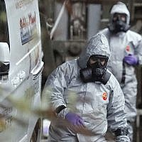 Military forces work on a van in Winterslow, England, Monday, March 12, 2018, as investigations continue into the nerve-agent poisoning of Russian ex-spy Sergei Skripal and his daughter Yulia. (AP Photo/Frank Augstein)