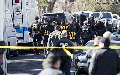 Authorities work on the scene after multiple explosions in Austin on Monday, March 12, 2018. (Ricardo B. Brazziell/Austin American-Statesman via AP)