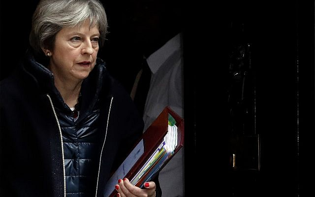 Britain's Prime Minister Theresa May leaves 10 Downing Street to attend the weekly Prime Minister's Questions session, in Parliament in London, Wednesday, March 14, 2018. (AP Photo/Frank Augstein)