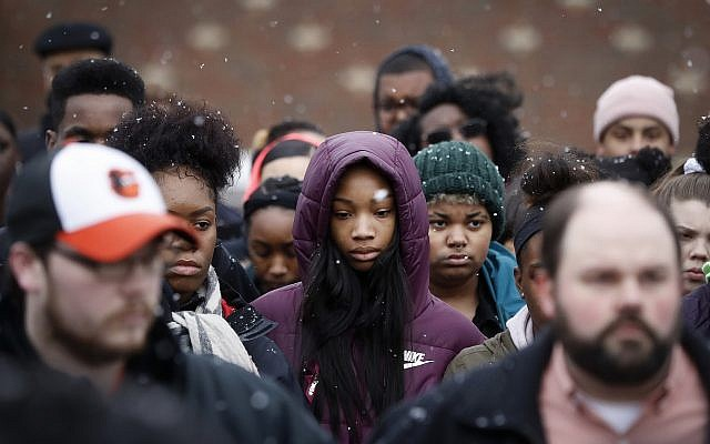 Students gather on their soccer field during a 17-minute walkout protest at the Stivers School for the Arts, March 14, 2018, in Dayton, Ohio. (AP Photo/John Minchillo)