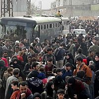 This photo shows Syrian civilians with their belongings, fleeing from fighting between the Syrian government forces and rebels, in eastern Ghouta, a suburb of Damascus, Syria, March. 15, 2018. (SANA via AP)
