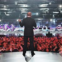 Russian President Vladimir Putin gestures while speaking at a youth forum 'Russia, Land of Opportunity' in Moscow, Russia, Thursday, March 15, 2018. (Alexei Druzhinin, Sputnik, Kremlin Pool Photo via AP)