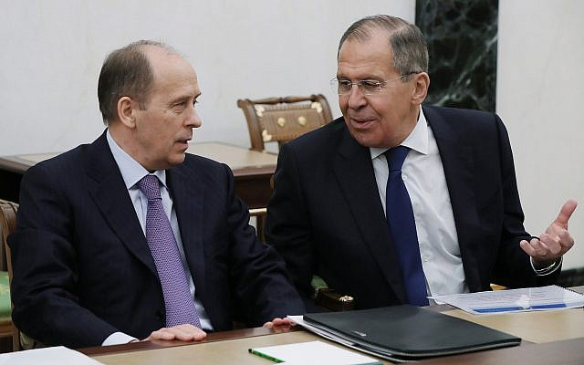 Russian Foreign Minister Sergey Lavrov (r) speaks to Federal Security Service (FSB) Director Alexander Bortnikov as they attend a security council meeting in the Kremlin in Moscow, Russia, March 15, 2018. (Mikhail Klimentyev, Sputnik, Kremlin Pool Photo via AP)