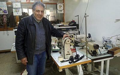 In this photo dated February 28, 2018, Ennahdha party candidate in the May municipal elections Simon Slama poses in his sewing machine repair shop in Monastir, Tunisia. (AP Photo/Mehdi Arem)