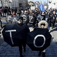Warsaw residents with anti-racism banners protests the rise of hostility and anti-Semitism in Poland, March 17, 2018. (AP Photo/Czarek Sokolowski)